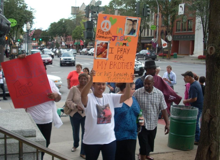 Friends, supporters and family members of Darryl Mount Jr. protest in front of Saratoga Springs City Hall in September 2013.