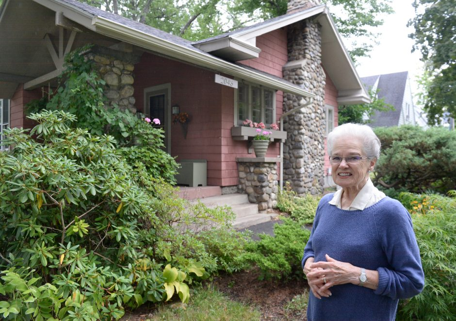 Marilyn Desimony in front of her home on Nott St.
