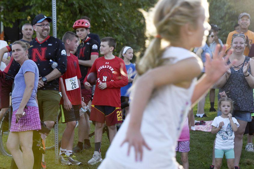 Runners finish in the 5k run during the 10th annual Nisky Fall Fun Run at Niskayuna Town Hall in Niskayuna on Saturday.