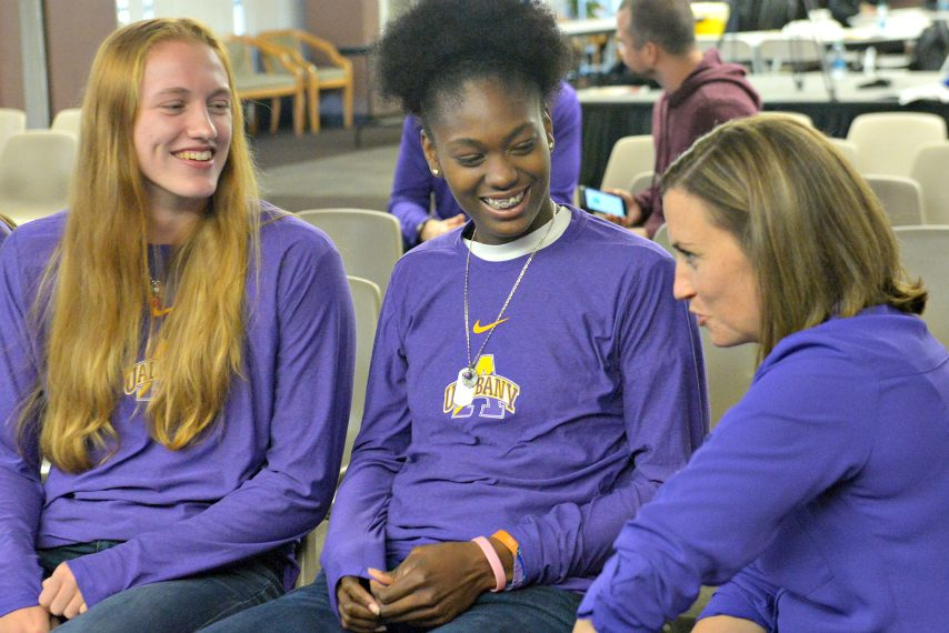 Heather Forster, left, and Chyanna Canada speak with UAlbany women's coach Colleen Mullen, right, at Tuesday's media day event.