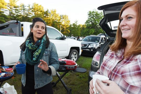 Kajori Simmons, of Northport (left), and Erika Ingranham, of Baldwinsville, chat while tailgating in the SPAC Saturday.