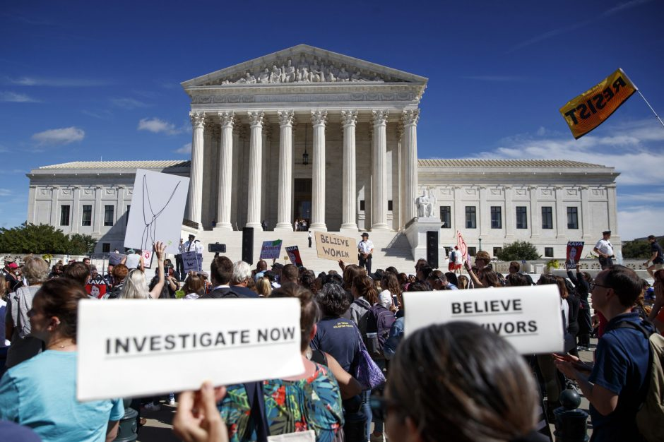 Protesters opposed to the nomination of Judge Brett Kavanaugh to the Supreme Court rally outside the court Friday.