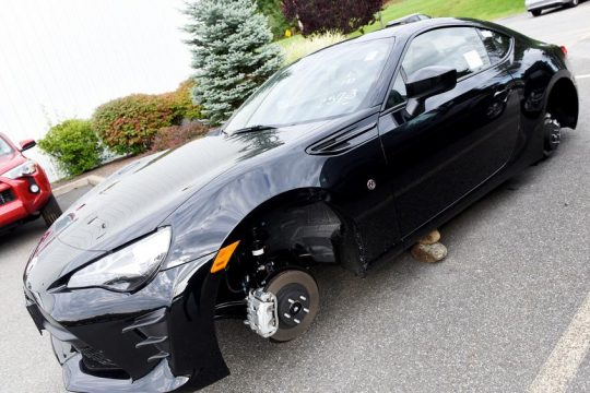 A car sits without wheels and on rocks Sunday at New Country Toyota of Clifton Park.