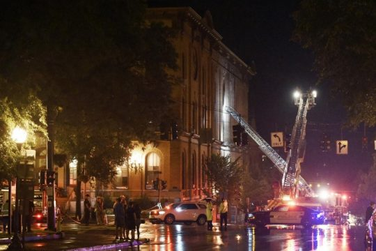 First responders put out a fire from a lightening strike at City Hall on Aug. 18.
