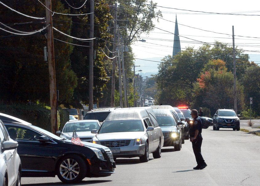 Hearses line up Tuesday outside Betz, Rossi, Bellinger & Stewart funeral home in Amsterdam, as bodies of victims arrive.