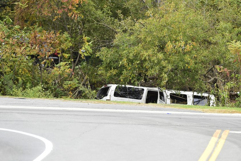 The top of a stretch limousine is all that can be seen after a collision in Schoharie.