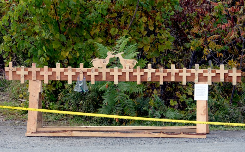 A wooden memorial where family, friends and the public can sign and give thoughts at the site of the crash in Schoharie.