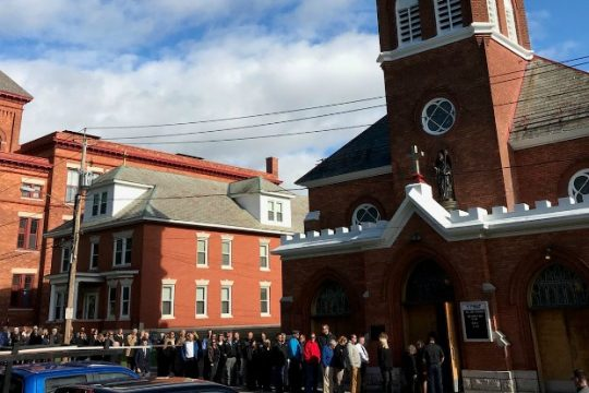 Mourners wait to pay their respects Friday to eight victims of last weekend's Schoharie crash