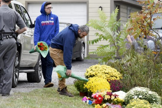 Flowers are laid Monday at the accident intersection and up Route 30 and Route 30A
