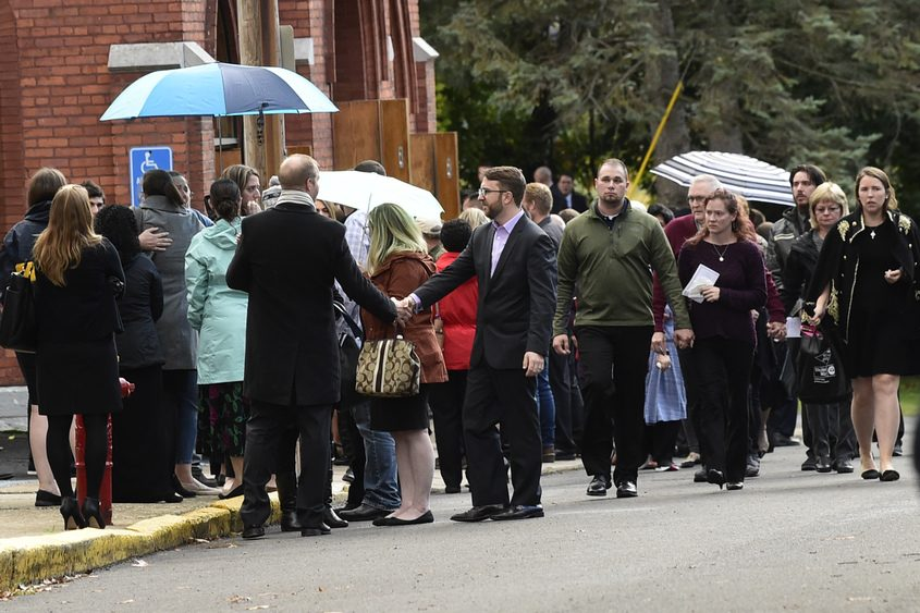 Mourners leave St. Stanislaus Roman Catholic Church on Cornell Street in Amsterdam Saturday