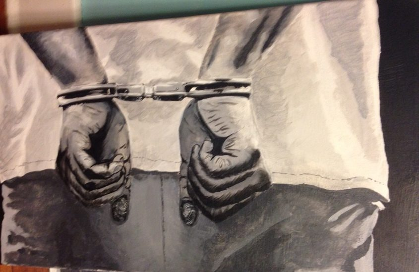 This photo shows a portion of a controversial painting at an school art show.