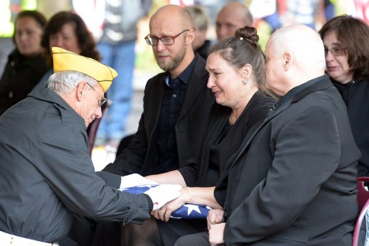A Saratoga National Cemetery Honor Guard Association volunteer thanks family members for Michael Ukaj's service to the country.