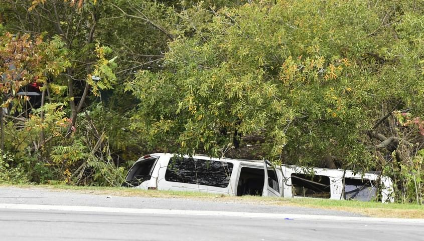 The top of a stretch limousine is seen after a collision in front of the Apple Barrel Country Store in Schoharie on Oct. 6.