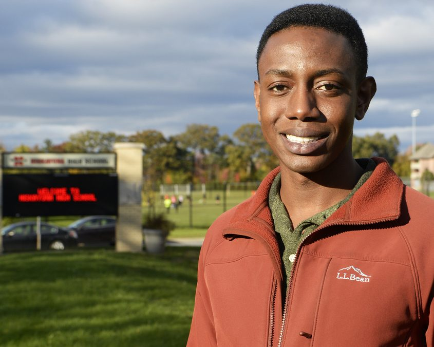 Naji Simmons stands in front of his alma mater Niskayuna High School on Balltown Road.