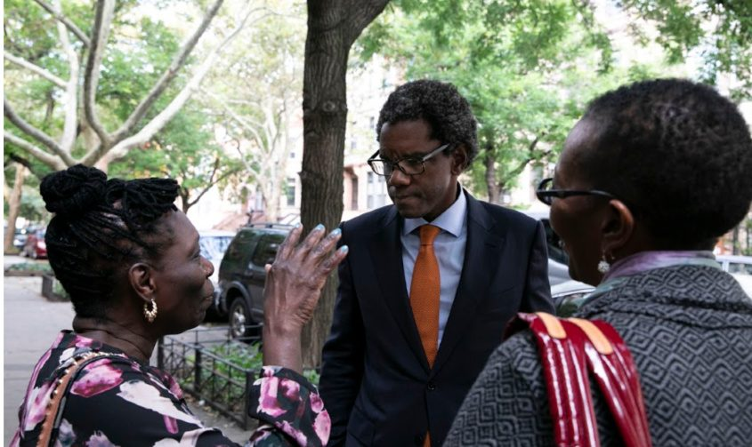 Keith Wofford speaks with speaks with residents of Brooklyn's Crown Heights neighborhood Oct. 4