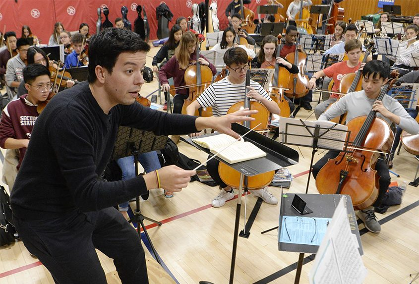 Carlos Agreda leads an ESYO rehearsal Tuesday at the Brown School in Schenectady.