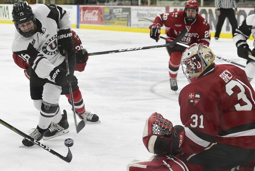 Union's Luc Brown gets off a shot at St. Lawrence goalie Arthur Brey.