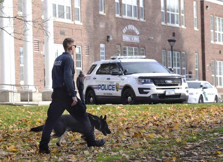 A State Parks Department officer tracks the grounds of Van Anterp Middle School on Story Avenue in Niskayuna Wednesday