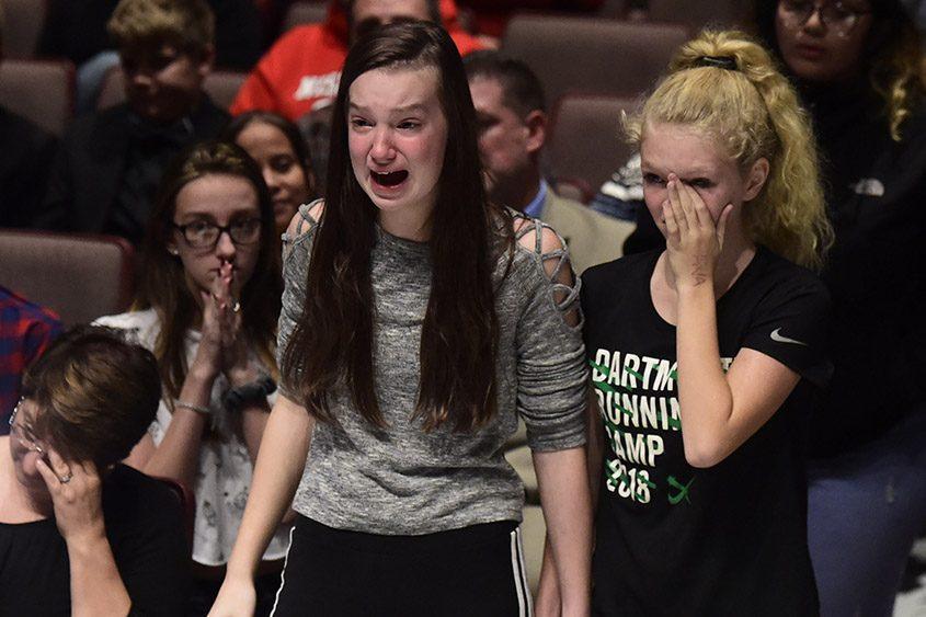 Niskayuna High School students Emily Chotkowski, left, and Ava Giagni get emotional during a forum on threats and lockdowns.