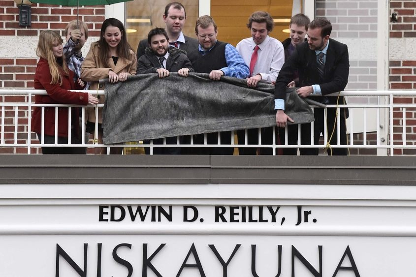 Members of the Reilly family unveil the name Edwin D. Reilly Jr. at Niskayuna Town Hall on Friday, Nov. 9, 2018.