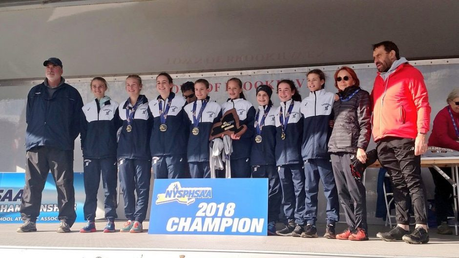 The Saratoga Springs girls' cross country team poses for a picture after winning the Class A state title.