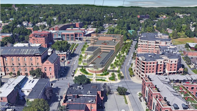 A rendering of the proposed parking garage, center, is shown.