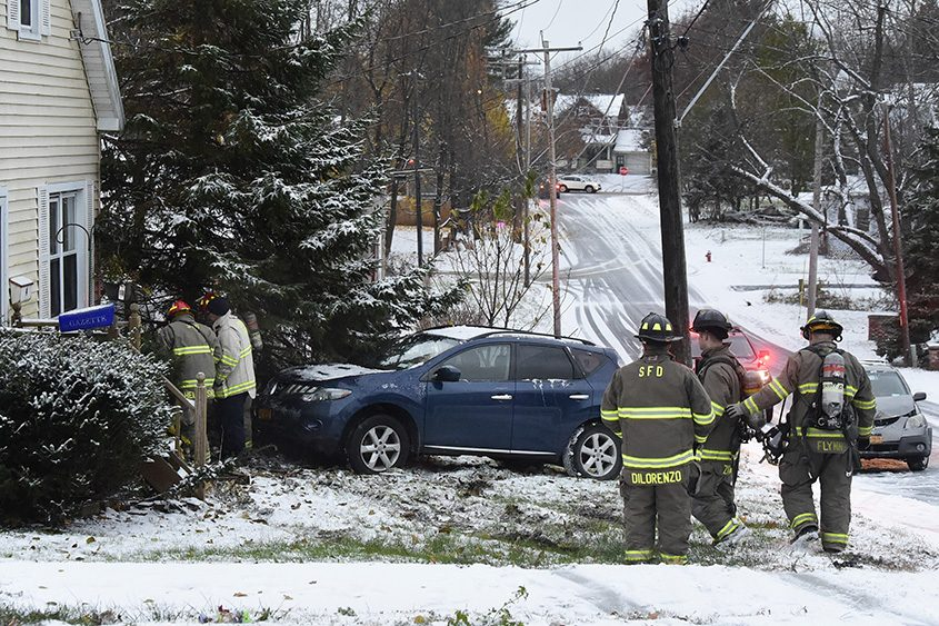 Schenectady firefighters look over a gas meter struck by a car at 4 Hillside Ave. in Schenectady on Wednesday.