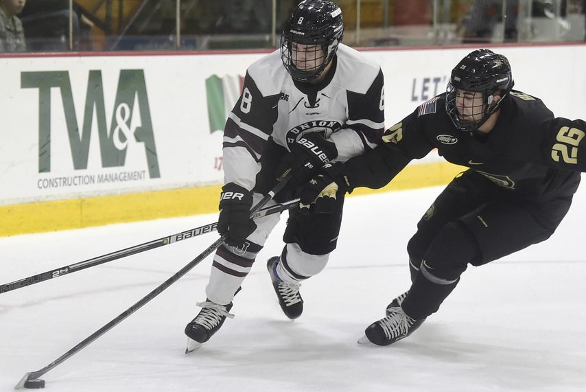 Union junior right wing Anthony Rinaldi controls the puck against Army on Oct. 3.