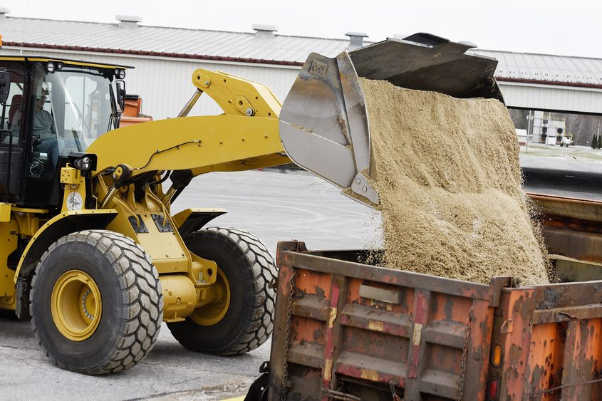 Heavy Equipment Operator John Becker, of Providence, fills a tandem truck with sand in preparation for Thursday's storm