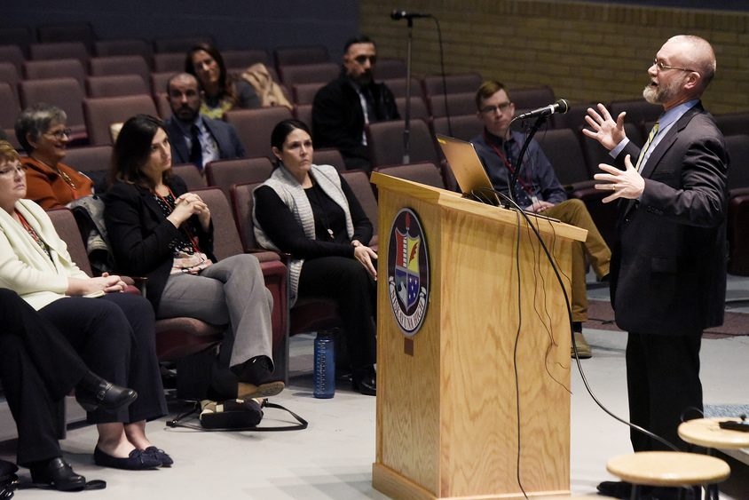 Niskayuna Superintendent Dr. Cosimo Tangorra, Jr., gives a presentation to crowd of parents and students during a forum Monday.