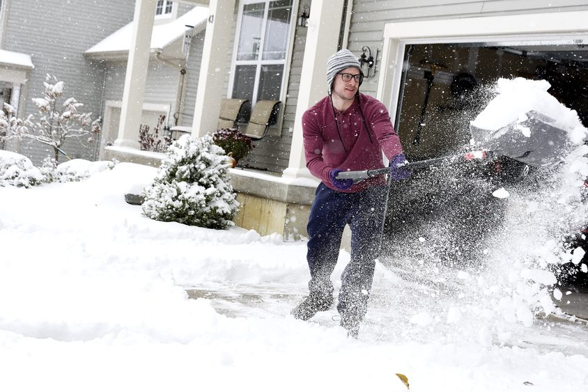 Nick Magina of Saratoga Springs shovels his driveway and sidewalk on Friday. More inclement weather could affect travael.