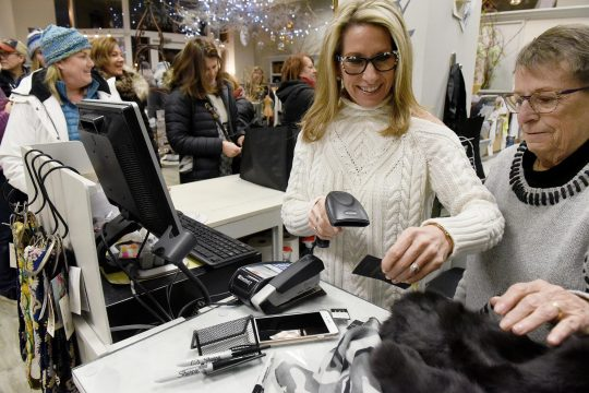 Shoppers hit the streets on Broadway for early morning sales during Black Friday Saratoga in Saratoga Springs on Friday.
