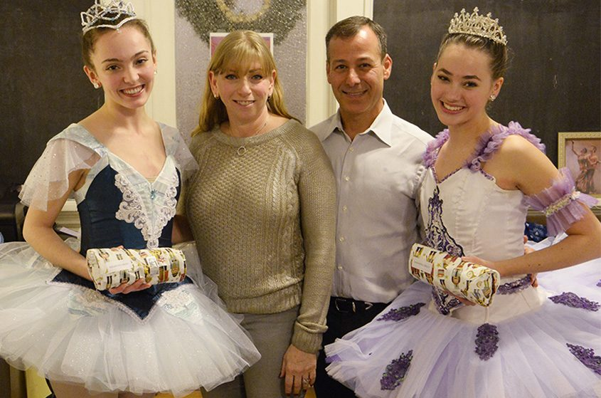 Andrea and David Golub (center) present new ballet pointe shoes to Northeast Dancers Kelseigh O'Brien, left, and Samantha Percy.