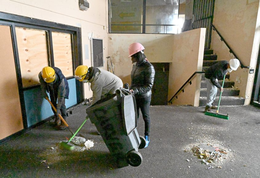 Pictured are Dong Quan, Keenan Chandler, and Shamecca Norfleet cleaning up the main lobby area.