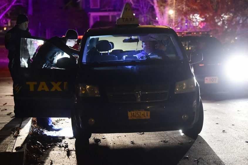 Schenectady Police officers question the driver of an Electric City Taxi driver who was robbed and assaulted early Thursday