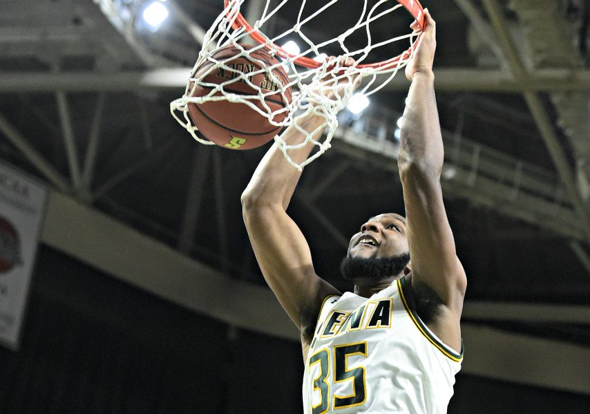 Sammy Friday dunks during Saturday's Siena basketball game.