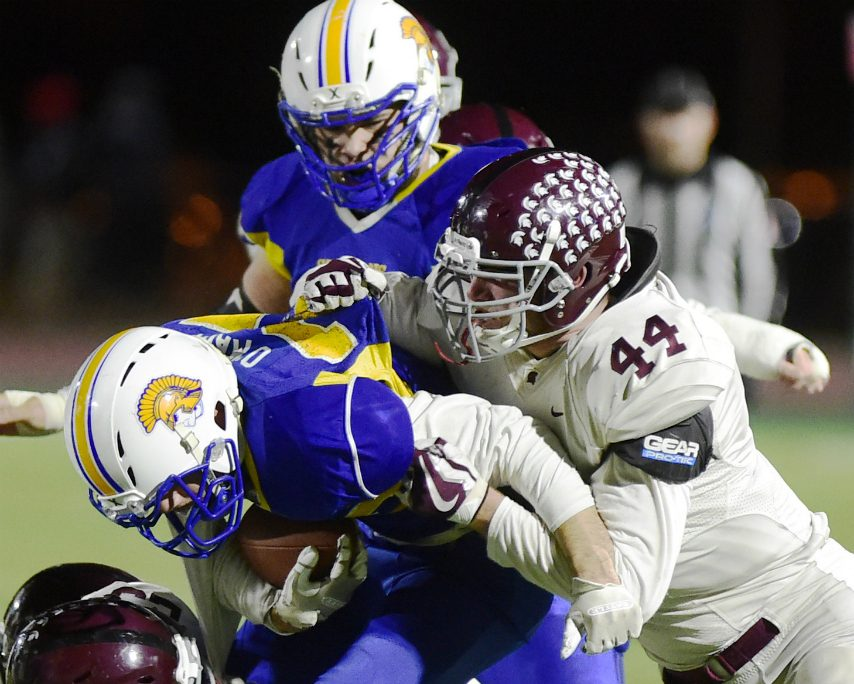 Burnt Hills-Ballston Lake linebacker Bryce Mussen makes a tackle in the Class A title game against Queensbury.