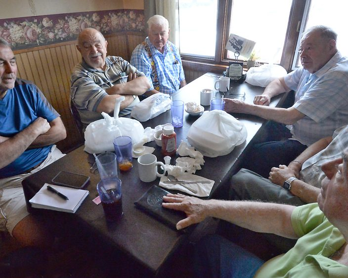 General Electric pensioners talk around the lunchtable at Jonathan's Pizza & Italian Cuisine in Duanesburg in this 2013 photo.