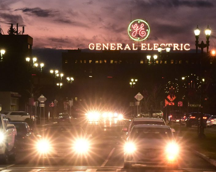 The iconic GE sign overlooks Erie Boulevard in Schenectady. The company recently cut stock dividends to a penny a share.