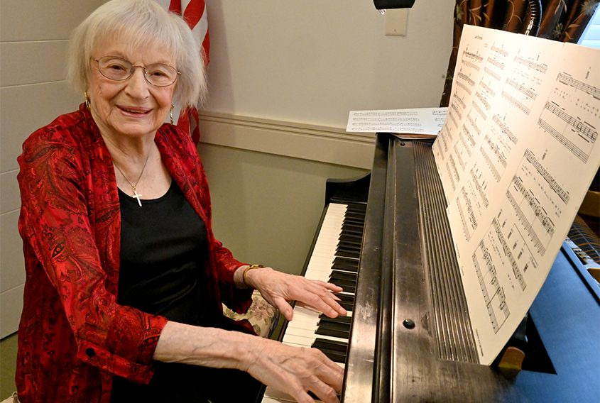 Ruby McGrory plays the piano in preparation for Tuesday's show at the Glendale Home.