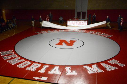 The Niskayuna wrestling team unveils a new mat dedicated to the late coach Joe Bena.