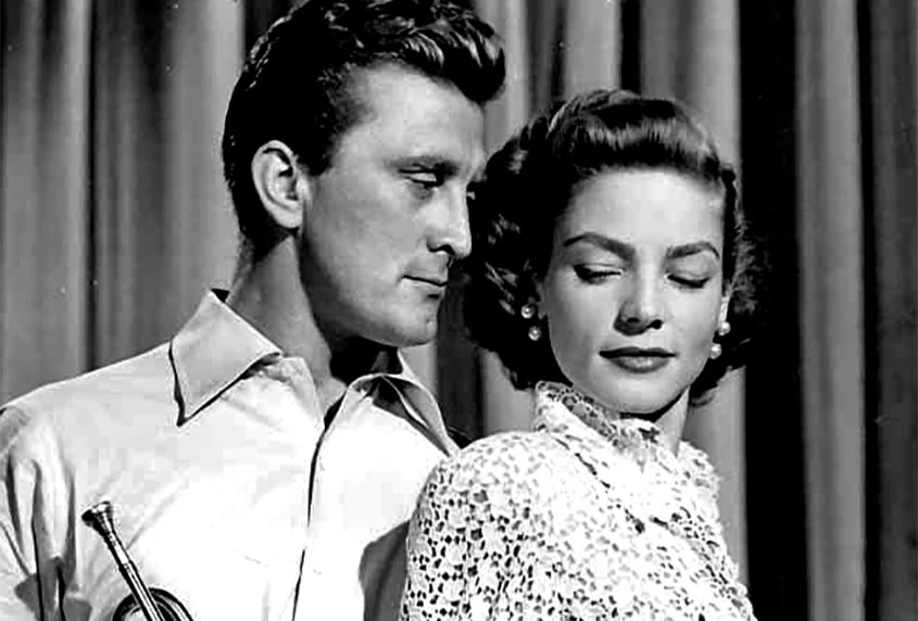 """Kirk Douglas and Lauren Bacall in a scene from the 1950 film """"Young Man with a Horn."""""""