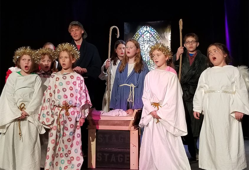 """Members of the cast perform a number during rehearsal for """"The Best Christmas Pageant Ever."""""""