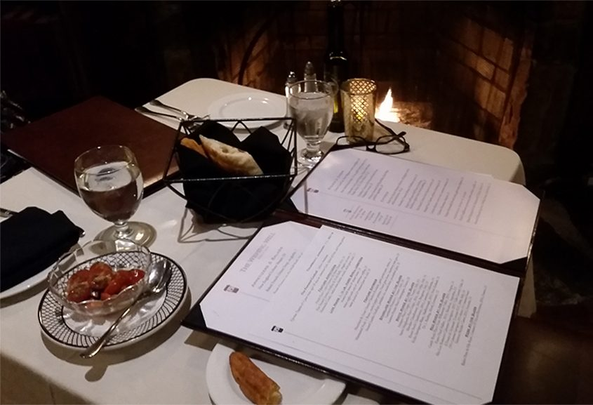 A cozy fireside table at the Wishing Well in Wilton.