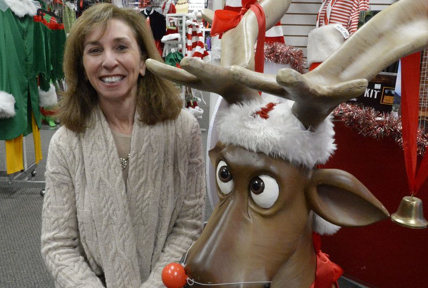 Bonnie Johnsen of the Costumer with a decorative reindeer in their Colonie store Wednesday.