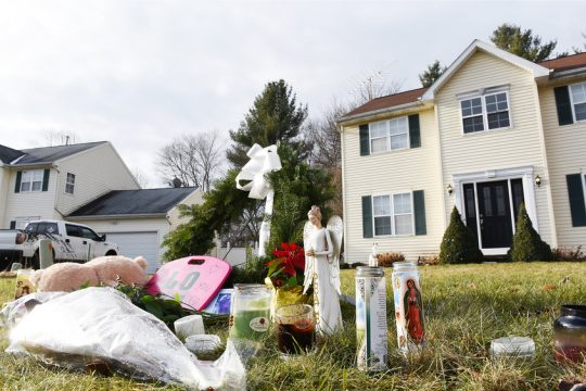 A memorial for the Jones family continued to grow Monday in front of their home on Adams Circle, Ballston Spa.