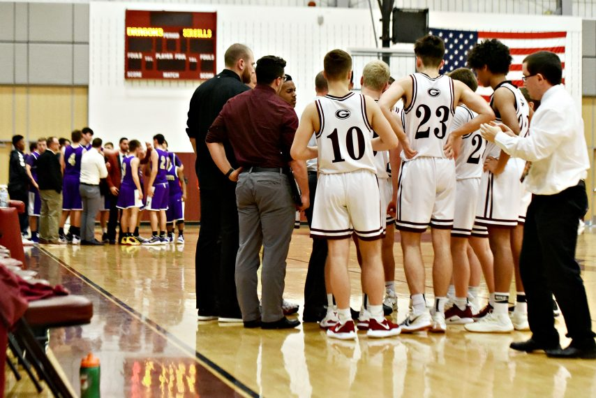 Players, coaches huddle during a recent Section II basketball game in Gloversville.