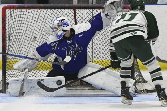 Saratoga Springs goalie Brad Blake makes a save on a shot by Shenendehowa's Brennan Alheim on Wednesday.