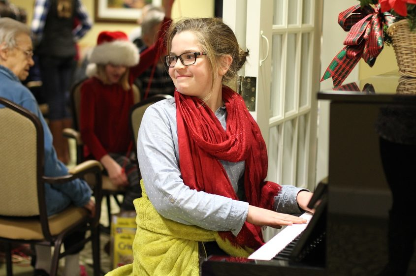 Caroline Skrebutenas gives an impromptu performance of Jingle Bells in 2014