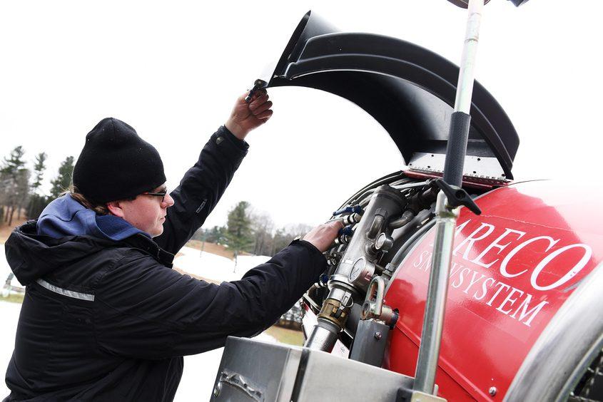 Maple Ski Ridge's Alex Kaczor checks on snow-making equipment as the resort readied for skiers Saturday.